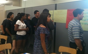 Students view comments from other journalism schools during a gallery walk at one of the first LAUSD journalism collaborative meetings in the fall 2010 at Los Angeles City College.